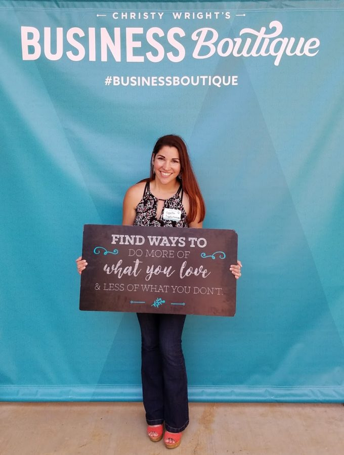 Coppelia Marie holds up an inspiring quote at Business Boutique