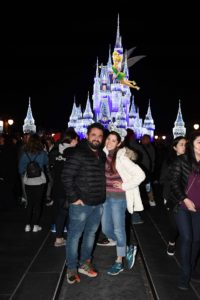 Couple in front of Cinderella's Castle at Disney's Magic Kingdom with Tinkerbell